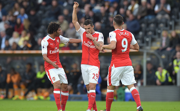 HULL, ENGLAND - SEPTEMBER 17: Granit Xhaka of Arsenal celebrates scoring his sides first goal with team mates during the Premier League match between Hull City and Arsenal at KCOM Stadium on September 17, 2016 in Hull, England. (Photo by Tony Marshall/Getty Images)